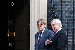 © Licensed to London News Pictures. 06/03/2018. London, UK. European Parliament Brexit co-ordinator Guy Verhofstadt (L) and Secretary of State for Exiting the European Union David Davis (R) walk up Downing Street. Photo credit: Rob Pinney/LNP