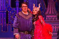 "© Licensed to London News Pictures. 06/12/2012. London, England. Priscilla Presley as the Wicked Queen with Jarred Christmas as the Henchman. Priscilla Presley makes her pantomime debut in ""Snow White and the Seven Dwarfs"" at the New Wimbledon Theatre, Wimbledon, from 7 December 2012 to 13 January 2013. Warwick Davis and Jarred Christmas star alongside her. Photo credit: Bettina Strenske/LNP"