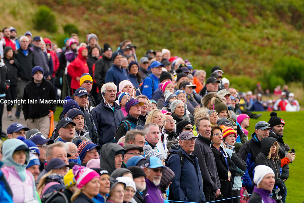 Auchterarder, Scotland, UK. 14 September 2019. Saturday afternoon Fourballs matches  at 2019 Solheim Cup on Centenary Course at Gleneagles. Pictured; Crowd of spectators watch approach shot to the 8th green.  Iain Masterton/Alamy Live News