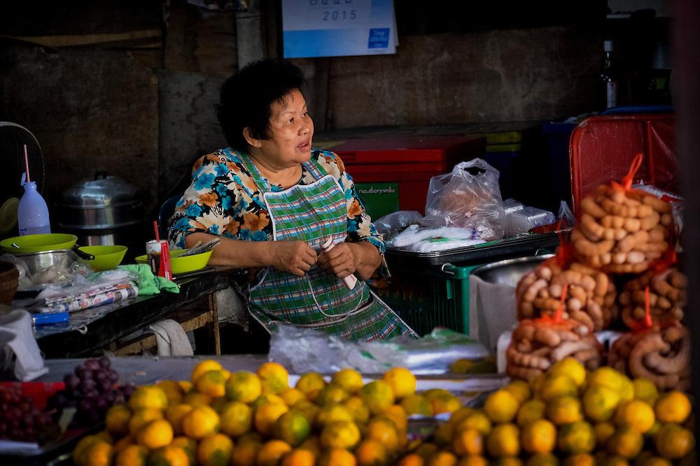 A Vendor at the Prachinburi market, Thailand PHOTO BY LEE CRAKER