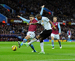 Manchester United's Ashley Young crosses  - Photo mandatory by-line: Joe Meredith/JMP - Mobile: 07966 386802 - 20/12/2014 - SPORT - football - Birmingham - Villa Park - Aston Villa v Manchester United - Barclays Premier League