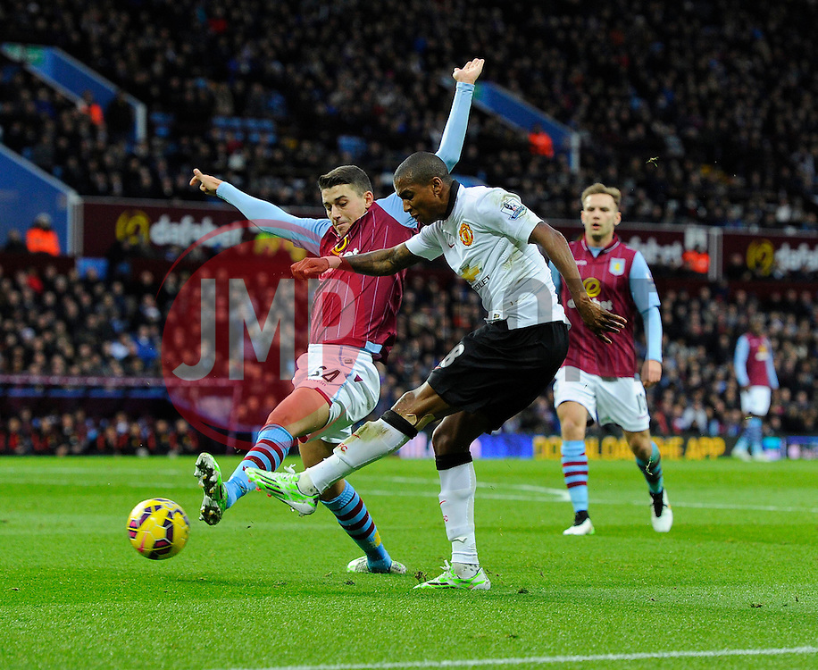 Manchester United's Ashley Young crosses  - Photo mandatory by-line: Joe Meredith/JMP - Mobile: 07966 386802 - 20/12/2014 - SPORT - football - Birmingham - Villa Park - Aston Villa v Manchester United - Barclays Premier League