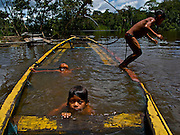 San Juan de Soco indigenous community members have determined that, because of increasing security in the region, tourism holds the key to their children's future. In 2008, they procured $25,000 in public funding to construct 5 tourist cabanas on their land. Comunidad Soco - Colombian Amazon.