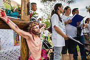 23 APRIL 2012 - PHOENIX, AZ:   Church lay leaders pray next to a crucifix at the Arizona State Capitol Monday. About 200 high school students from across the Phoenix metropolitan area rallied at the Arizona state capitol in Phoenix Monday to show their opposition to Arizona's tough anti-immigration law, SB 1070. April 23 is the 2nd anniversary of the law's signing. The US Supreme Court is taking up the law during a hearing Wednesday, April 25 in Washington DC.      PHOTO BY JACK KURTZ