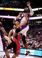 Mar. 23, 2011; Phoenix, AZ, USA; Phoenix Suns guard Mickael Pietrus (12) goes up for a rebound against the Toronto Raptors at the US Airways Center. Mandatory Credit: Jennifer Stewart-US PRESSWIRE