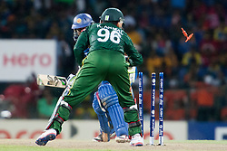 © Licensed to London News Pictures. 04/10/2012. Pakistani wicketkeeper Kamran Akmal stumps out Sri Lankan Jeevan Mendis during the World T20 Cricket Mens Semi Final match between Sri Lanka Vs Pakistan at the R Premadasa International Cricket Stadium, Colombo. Photo credit : Asanka Brendon Ratnayake/LNP