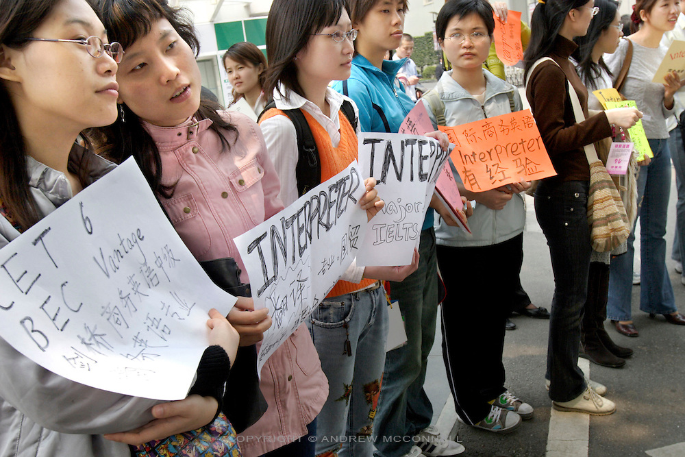 Chinese women hoping for Interpreter work from foreign businesses visting the Trade Fair in Guangzhou, southern China on Thursday, 14th, Apr. 2005.