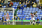 Jack Butland (1) of Stoke City gets his finger tips to the ball to deflect it away from danger during the EFL Sky Bet Championship match between Reading and Stoke City at the Madejski Stadium, Reading, England on 1 December 2018.