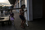 Mothers help with materials after a ballet class outside the Biblioteca Parque in Manguinhos neighbourhood in Rio de Janeiro, Brazil, Monday, June 11, 2018.  The Manguinhos community ballet has been a reprieve from the violence and poverty that afflicts its namesake neighborhood for hundreds of girls who have benefitted from free dance classes since 2012. (Dado Galdieri for The New York Times)