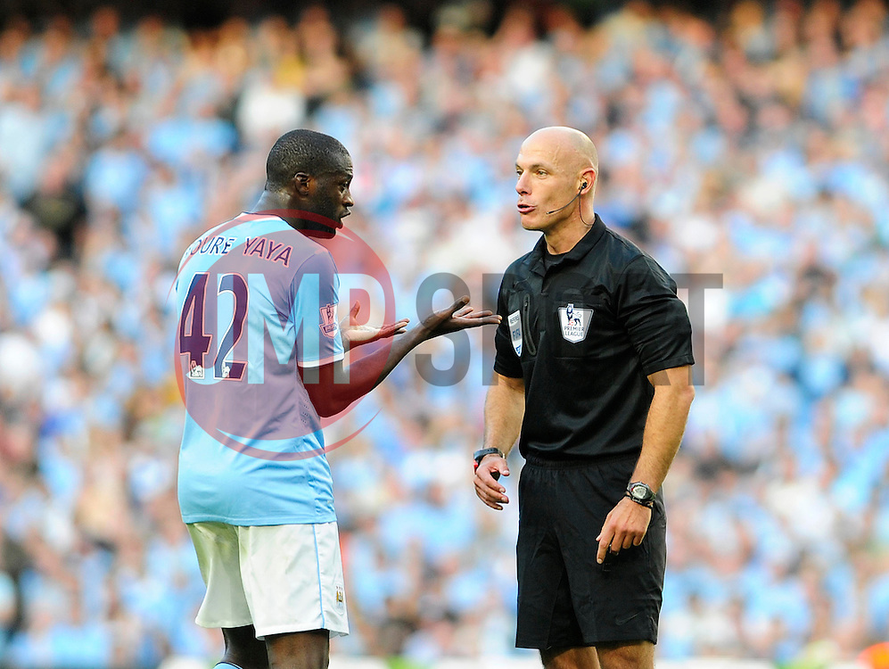 Referee, Howard Webb talks with Manchester City's Yaya Toure - Photo mandatory by-line: Dougie Allward/JMP - Tel: Mobile: 07966 386802 22/09/2013 - SPORT - FOOTBALL - City of Manchester Stadium - Manchester - Manchester City V Manchester United - Barclays Premier League