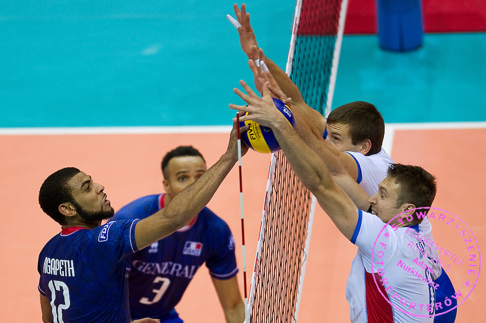 (L) Earvin Ngapeth from France attacks against (R) Robert Hupka from Slovakia during the 2013 CEV VELUX Volleyball European Championship match between France and Slovakia at Ergo Arena in Gdansk on September 20, 2013.<br /> <br /> Poland, Gdansk, September 20, 2013<br /> <br /> Picture also available in RAW (NEF) or TIFF format on special request.<br /> <br /> For editorial use only. Any commercial or promotional use requires permission.<br /> <br /> Mandatory credit:<br /> Photo by &copy; Adam Nurkiewicz / Mediasport