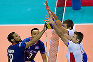 (L) Earvin Ngapeth from France attacks against (R) Robert Hupka from Slovakia during the 2013 CEV VELUX Volleyball European Championship match between France and Slovakia at Ergo Arena in Gdansk on September 20, 2013.<br /> <br /> Poland, Gdansk, September 20, 2013<br /> <br /> Picture also available in RAW (NEF) or TIFF format on special request.<br /> <br /> For editorial use only. Any commercial or promotional use requires permission.<br /> <br /> Mandatory credit:<br /> Photo by © Adam Nurkiewicz / Mediasport