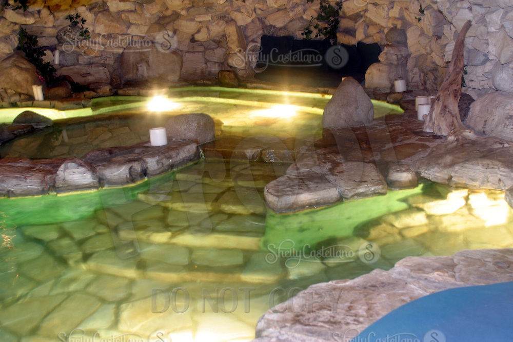 9 July 2002: EXCLUSIVE Photo. The famous grotto inside a cave at the playboy mansion, home of Hugh Hefner's 5.5 acre estate near UCLA in Los Angeles, CA. USA.<br /> <br /> 1973, famed Playboy publisher/editor Hugh Hefner introduced the world to his version of a modern-day Xanadu, the iconic property known as the Playboy Mansion West. A wildly imaginative adult playground, the property conveyed the extreme luxury and personal freedom that reflected the cultural ethos embodied in Hefner&rsquo;s revolutionary publication.<br /> <br /> Located in Holmby Hills, a wealthy Los Angeles enclave famous for its celebrity residents, the 5.3-acre estate features a 29-room Gothic/Tudor estate home originally built in 1927. Hefner purchased the property in 1970 and quickly set in motion a massive renovation that would result in one of the most photographed, distinctive and storied residences of the 20th Century.