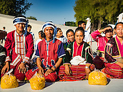 "02 JANUARY 2016 - KHLONG LUANG, PATHUM THANI, THAILAND:  Hill tribe people from northern Thailand, on the border with Myanmar, wait for the start of a mass pilgrimage of Buddhist monks at Wat Phra Dhammakaya on the first day of the 5th annual Dhammachai Dhutanaga (a dhutanga is a ""wandering"" and translated as pilgrimage). More than 1,300 monks are participating pilgrimage through central Thailand. The purpose of the pilgrimage is to pay homage to the Buddha, preserve Buddhist culture, welcome the new year, and ""develop virtuous Buddhist youth leaders."" Wat Phra Dhammakaya is the largest Buddhist temple in Thailand and the center of the Dhammakaya movement, a Buddhist sect founded in the 1970s. The monks are using busses on some parts of the pilgrimage this year after complaints about traffic jams caused by the monks walking along main highways.         PHOTO BY JACK KURTZ"