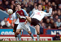 Photo. Matthew Lewis.<br /> Aston Villa v Manchester United. FA Cup 3rd Rd. 04/01/2004.<br /> <br /> Manchester's Nicky Butt holds off Aston Villa's Gareth Barry.