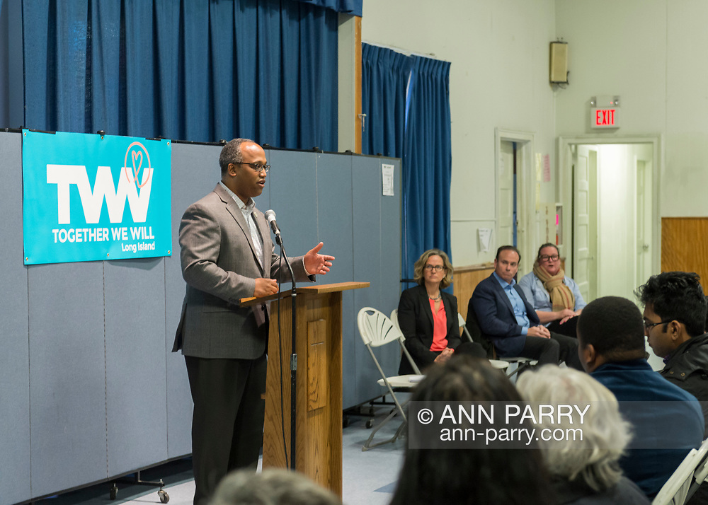 Wyandanch, New York, USA. March 26, 2017. At podium, DuWAYNE GREGORY, Presiding Officer and Suffolk County Legislator (Democrat - District 15), is speaking at Politics 101 event, the first of series of activist training workshops for members of TWW LI, the Long Island affiliate of national Together We Will. Speakers seated right of him are, L-R, LAURA CURRAN, JAY JACOBS, and LAUREN CORCORAN-DOOLIN.