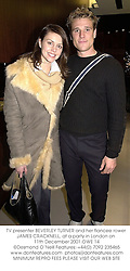 TV presenter BEVERLEY TURNER and her fiancee rower JAMES CRACKNELL, at a party in London on 11th December 2001.	OWE 14