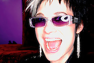close up of smiling woman with sunglasses