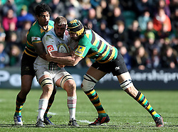 Chris Robshaw of Harlequins is tackled by Ken Pisi of Northampton Saints and Paul Hill of Northampton Saints - Mandatory by-line: Robbie Stephenson/JMP - 27/03/2016 - RUGBY - Franklin's Gardens - Northampton, England - Northampton Saints v Harlequins - Aviva Premiership