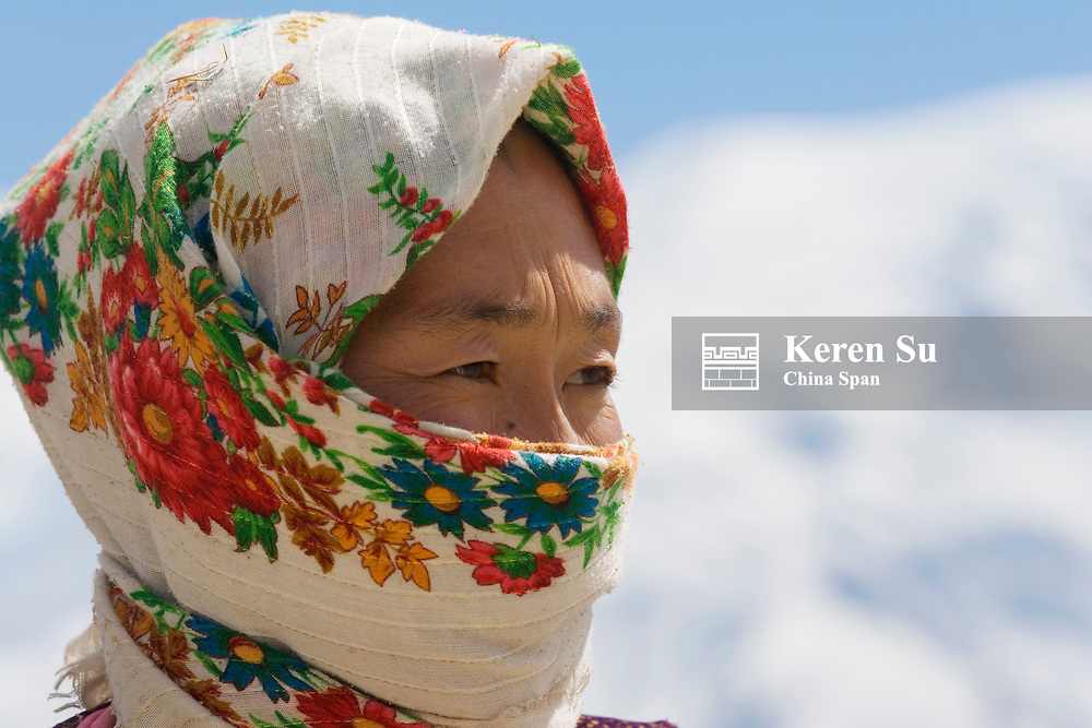 Kyrgyz woman covered by scarf on Pamir Plateau, Xinjiang, Silk Road, China