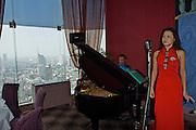 View over Bangkok from Shanghai 38 restaurant on the 38th floor of Sofitel Silom Bangkok. Jazz concert during Sunday brunch.