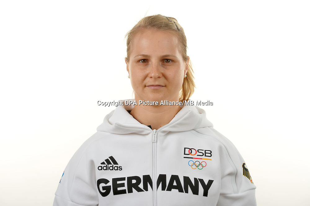 Sabine Kusterer poses at a photocall during the preparations for the Olympic Games in Rio at the Emmich Cambrai Barracks in Hanover, Germany. July 06, 2016. Photo credit: Frank May/ picture alliance. | usage worldwide