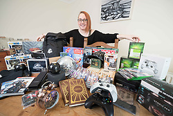 Faye Bradley at home in Ennis , Co Clare Ireland with some of the 180 prizes. Photograph by Eamon Ward