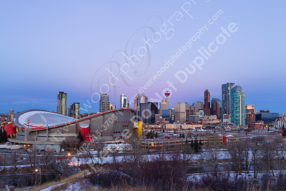 I got up bright and early to go out and photograph the Total Lunar Eclipse at Sunrise from Scotsman's Hill. The timing was perfect to see the moon settle down between the Calgary Tower and the other adjacent buildings of the Calgary Skyline. It was a lovely morning and a beautiful sight to see.<br /> <br /> &copy;2011, Sean Phillips<br /> http://www.RiverwoodPhotography.com