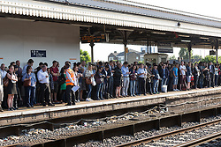 © Licensed to London News Pictures. 09/07/2015. London, UK. Crowded train platforms at Clapham Junction station in south London. A tube strike today has closed the TfL London Underground network and has been called by Trade Unions in protest over the new all-night tube trains, due to start in mid-September.. Photo credit : Vickie Flores/LNP