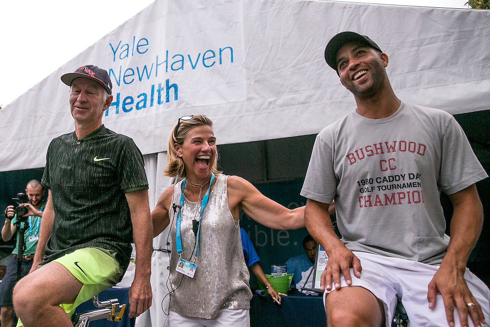 August 25, 2016, New Haven, Connecticut: <br /> John McEnroe and James Blake ride the spin bikes alongside Tournament Director Anne Worcester at the Yale New Haven Health booth during the Men's Legends Event on Day 7 of the 2016 Connecticut Open at the Yale University Tennis Center on Thursday, August  25, 2016 in New Haven, Connecticut. <br /> (Photo by Billie Weiss/Connecticut Open)