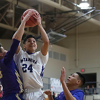 Miyamura's Darin Baca (24) takes a shot against Kirtland Central Thursday night in Gallup.