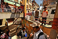 People come and go from the market in Coroico, where many people from the Yungas region come to sell their coca leaves.