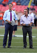(L-R) Former Cincinnati Bengals wide receiver and present day NBC Sports television color analyst Cris Collinsworth looks on with NBC Sports play by play announcer Al Michaels before the Carolina Panthers 2016 NFL week 1 regular season football game against the Denver Broncos on Thursday, Sept. 8, 2016 in Denver. The Broncos won the game 21-20. (©Paul Anthony Spinelli)