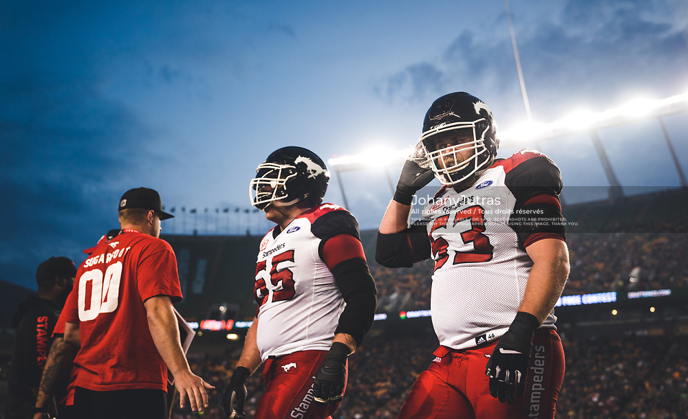 Brad Erdos (53) and Dan Federkeil (65) of the Calgary Stampeders during the game against the Edmonton Eskimos at Commonwealth Stadium in Edmonton AB, Saturday, September 9, 2017. (Photo: Johany Jutras)