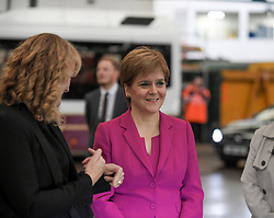 Pictured: The First Minister tours a bus garage.<br /> <br /> First Minister Nicola Sturgeon emphasised the need for climate change to be at the heart of the programme for Government, ahead of the announcement, on a visit to Lothian Buses depot in Edinburgh.<br /> <br /> © Dave Johnston / EEm