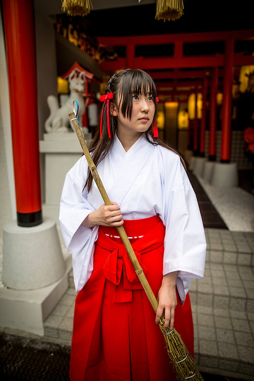 """TOKYO, JAPAN - JUNE 27 : A shrine maiden posed for a portrait in front of the entrance of Akihabara shrine in Akihabara, Tokyo, Japan. June 27, 2016. A newly opened Akihabara Shrine offers a memorial services for """"deceased"""" anime figures. Photo by Richard Atrero de Guzman"""