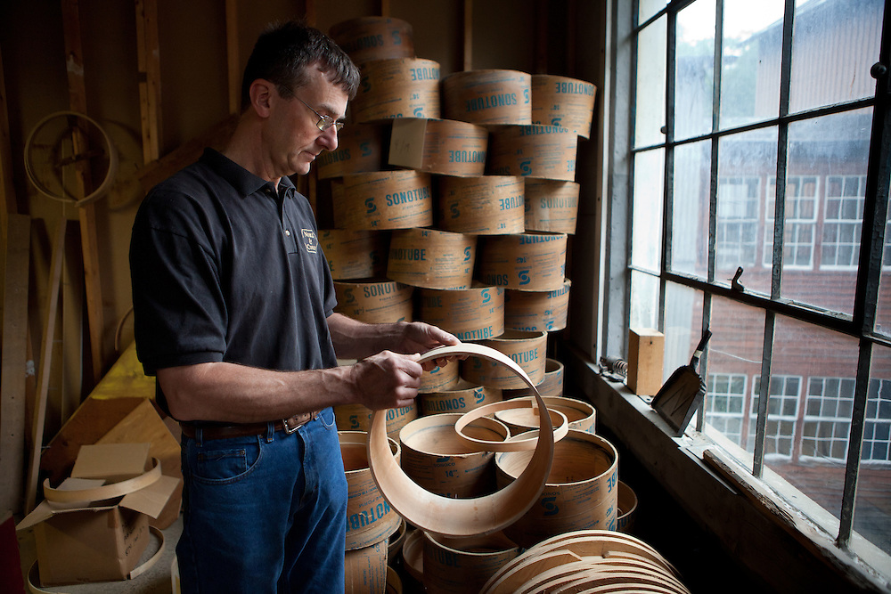 Sixth generation drum maker Jay Jones, President of Noble & Cooley, holds a red oak shell for a snare drum at Noble & Cooley in Granville, MA on June 23, 2011. The family owned business has been making drums of one kind or another since 1854.  (Matthew Cavanaugh for The Boston Globe)
