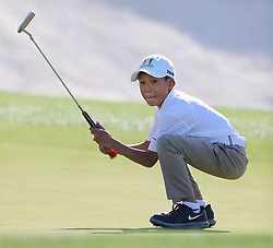 April 1, 2018 - Augusta, GA, USA - Taighan Chea, Bothell, Wash., reacts to sinking his putt on the 18th green during the Drive Chip & Putt National Finals at Augusta National Golf Club on Sunday, April 1, 2018, in Augusta, Ga. The putt gave Chea the 7-9-year-old boys putting title and the overall championship for his age group. (Credit Image: © Curtis Compton/TNS via ZUMA Wire)
