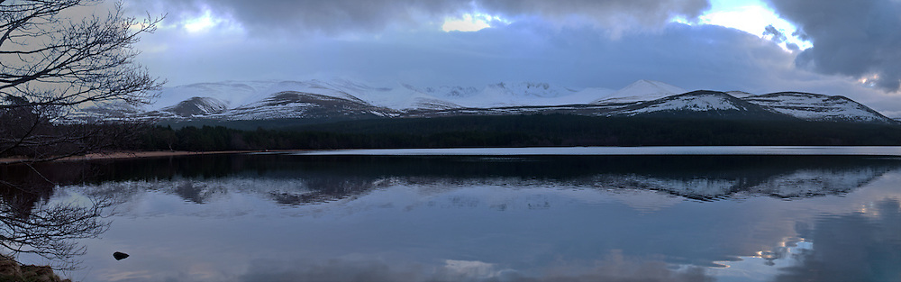 Loch Morlich and snow capped Cairngorms