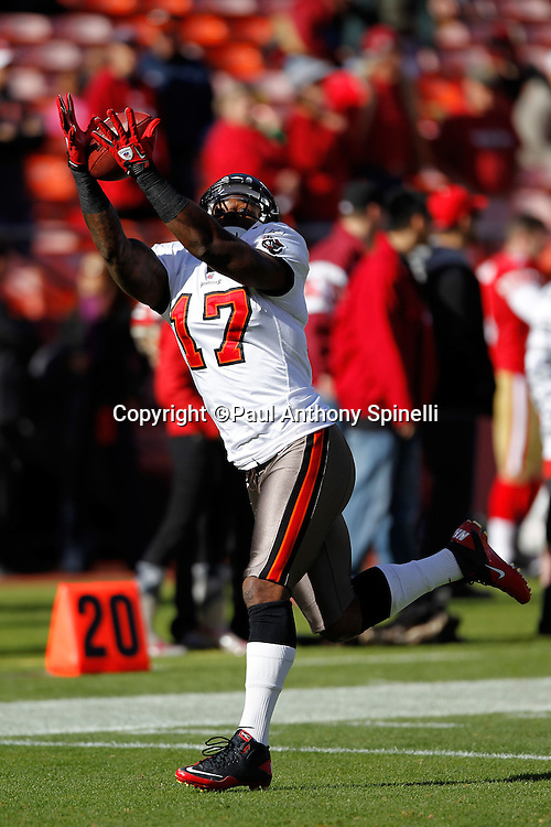 Tampa Bay Buccaneers wide receiver Arrelious Benn (17) stretches to catch a pregame pass during the NFL week 11 football game against the San Francisco 49ers on Sunday, November 21, 2010 in San Francisco, California. The Bucs won the game 21-0. (©Paul Anthony Spinelli)