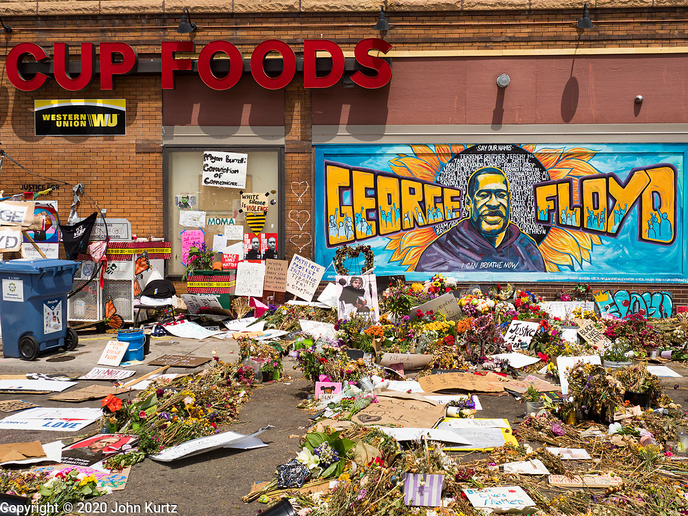 "12 JUNE 2020 - MINNEAPOLIS, MINNESOTA: The impromptu community memorial for George Floyd at the corner of 38th Street and Chicago Ave. in Minneapolis. The intersection is informally known as ""George Floyd Square"" and is considered a ""police free zone."" There are memorials to honor Black people killed by police and people providing free food at the intersection. Floyd, an unarmed Black man, was killed by Minneapolis police on May 25 when an officer kneeled on his neck for 8 minutes and 46 seconds. Floyd's death sparked weeks of ongoing protests and uprisings against police violence around the world.          PHOTO BY JACK KURTZ"