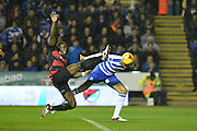 early header on goal by Reading's Michael Hector defended by Queens Park Rangers defender Nedum Onuoha during the Sky Bet Championship match between Reading and Queens Park Rangers at the Madejski Stadium, Reading, England on 3 December 2015. Photo by Mark Davies.