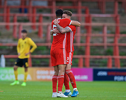WREXHAM, WALES - Friday, September 6, 2019: Wales' captain Regan Poole (L) and Wales' Cameron Coxe celebrate at the final whistle during the UEFA Under-21 Championship Italy 2019 Qualifying Group 9 match between Wales and Belgium at the Racecourse Ground. Wales won 1-0. (Pic by Laura Malkin/Propaganda)