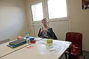 Martine 56 ans, attends que la journée passe. Depuis quatre mois les ouvrières de Sodimédical, à Plancy l'Abbaye (10) pointent tous les matins à 7h15 mais à la fin du mois aucun salaire ne tombe. En 2010 le groupe Lohmann & Rauscher a annoncé la fermeture de cette usine de matériel médical et le licenciement de ses 54 salariés pour délocaliser l'activité en Chine. Malgré plusieurs décisions de justice qui ont invalidé les plans sociaux , le groupe ne confie plus de travail aux ouvrières. Sans travail mais aussi sans chômage, les ouvriers sont chaque jour 8 heures à l'usine, tricotant, jouant aux cartes ou marchant en rond dans le parking, en attendant une décision.l'usine de Sodimédical. Elle a 16 ans d'ancienneté dans l'usine. Elle soudait des champs opératoires. Depuis quatre mois les ouvrières de Sodimédical, à Plancy l'Abbaye (10) pointent tous les matins à 7h15 mais à la fin du mois aucun salaire ne tombe. En 2010 le groupe Lohmann & Rauscher a annoncé la fermeture de cette usine de matériel médical et le licenciement de ses 54 salariés pour délocaliser l'activité en Chine. Malgré plusieurs décisions de justice qui ont invalidé les plans sociaux , le groupe ne confie plus de travail aux ouvrières. Sans travail mais aussi sans chômage, les ouvriers sont chaque jour 8 heures à l'usine, tricotant, jouant aux cartes ou marchant en rond dans le parking, en attendant une décision.
