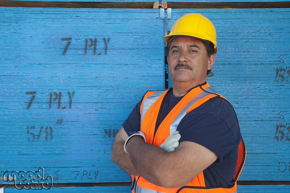 Portrait of a warehouse worker with arms crossed