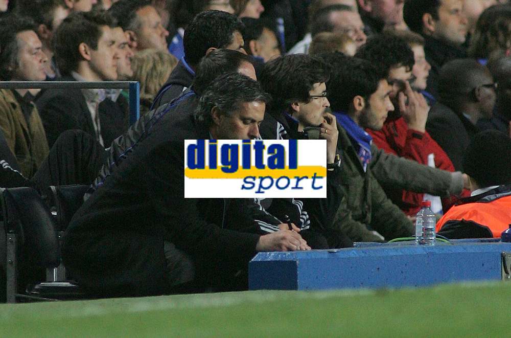 Photo: Paul Thomas.<br /> Chelsea v Valencia. UEFA Champions League. Quarter Final, 1st Leg. 04/04/2007.<br /> <br /> Manager Jose Mourinho of Chelsea wrights down some team-talk notes before half time.