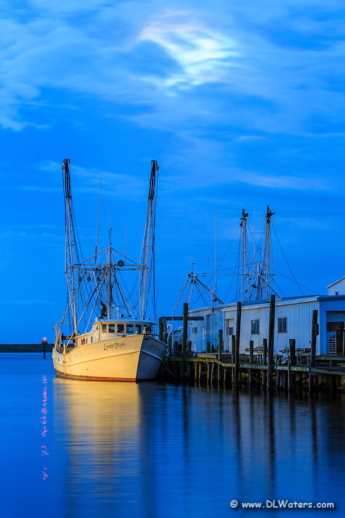 Twilight fishing trawler in Wanchese on the Outer Banks of NC.