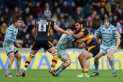 Wasps Number 8 (#8) Billy Vunipola is tackled by Leicester Flanker (#7) Julian Salvi during the first half of the match - Photo mandatory by-line: Rogan Thomson/JMP - Tel: Mobile: 07966 386802 25/11/2012 - SPORT - RUGBY - Adams Park - High Wycombe. London Wasps v Leicester Tigers - Aviva Premiership.
