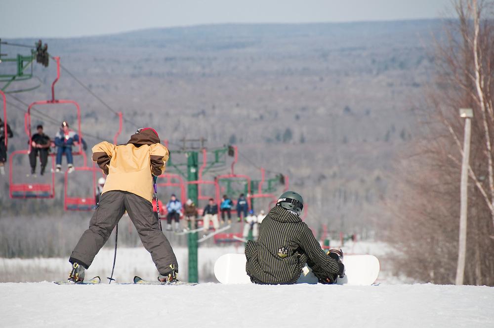 Skiing and snowboarding at Indianhead Mountain ski resort in Wakefield Michigan.