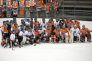 RIT and Pursuit of Excellence players pose for a group photo after an exhibition game at RIT's Gene Polisseni Center on Monday, September 29, 2014.